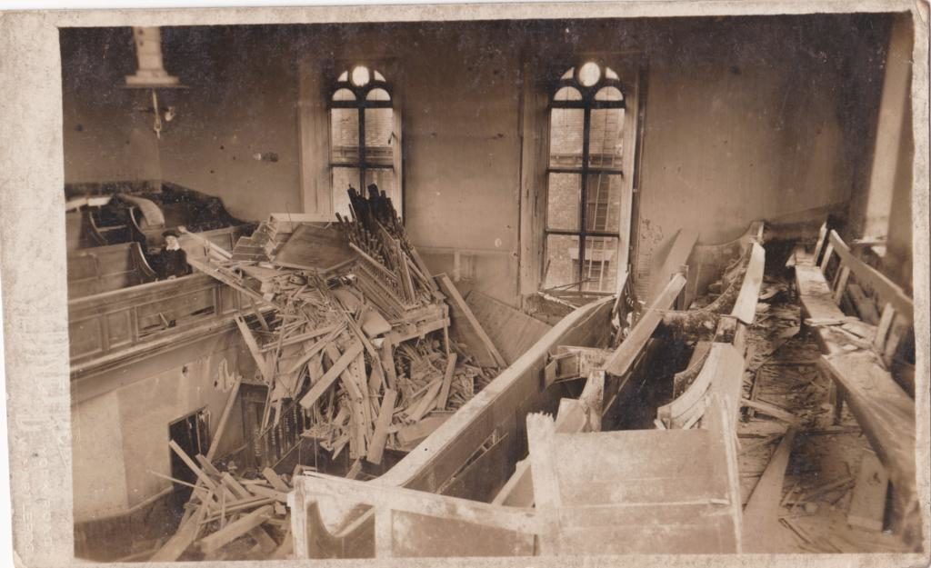 View towards the rar of the Chapel showing destroyed Organ. The Little boy is Alan Illingworth; later to become Churh Secretary.